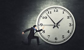 image of running-late  - Concept of time with funny businessman running in a hurry - JPG