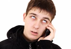 stock photo of annoying  - Annoyed Teenager with Cellphone Isolated on the White Background - JPG