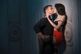 stock photo of short legs  - Couple kissing passionately - JPG