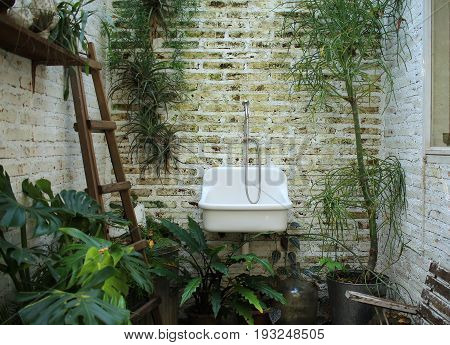 Image of old sink on brick background
