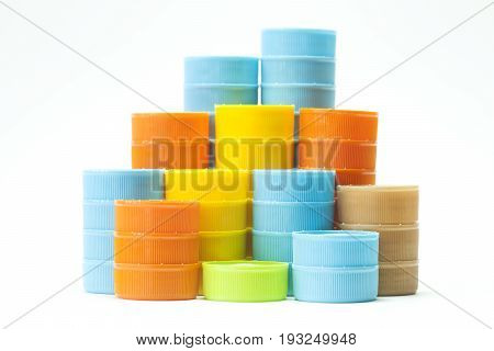 Colorful plastic bottle screw caps on white