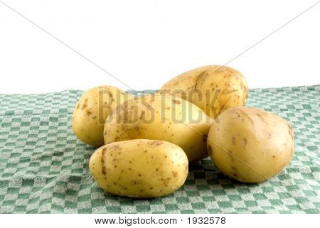 Potatoes On A Green Tea-Cloth