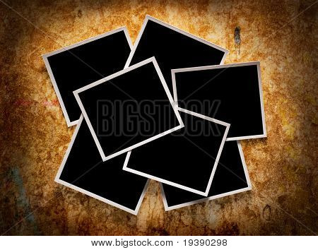 Seven blank  instant photos over wooden background