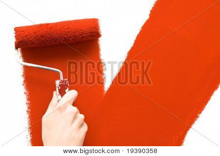 Painting the wall with red roller