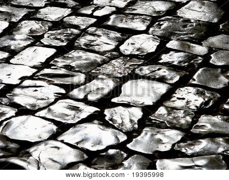 Roadway with shining as metal stones