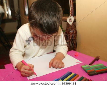 The boy writes words