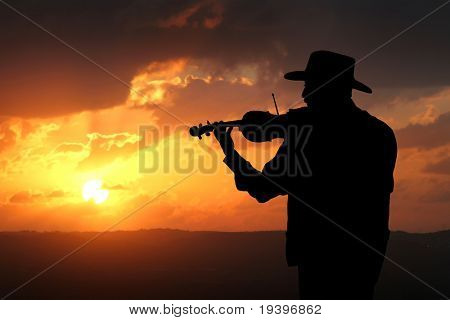 The violinist on a sunset