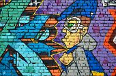 Detailed Image Of Color Graffiti Drawing. Background Street Art Background With A Painted Character. poster