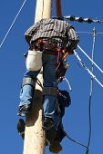pic of lineman  - an electrical lineman student working on a pole at a lineman college - JPG
