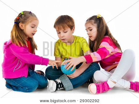 Kids with a globe of the world over white background