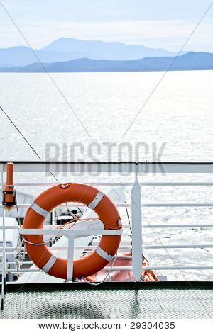 Life buoy with beacon on a ship