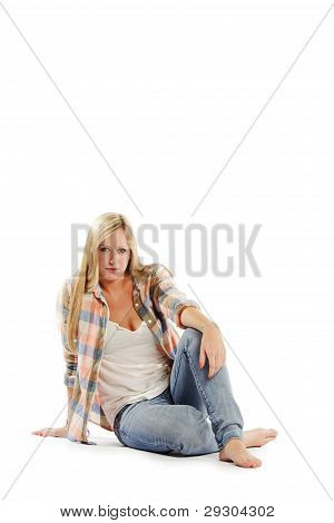 Portrait Of Attractive Young Female Sitting On White Background