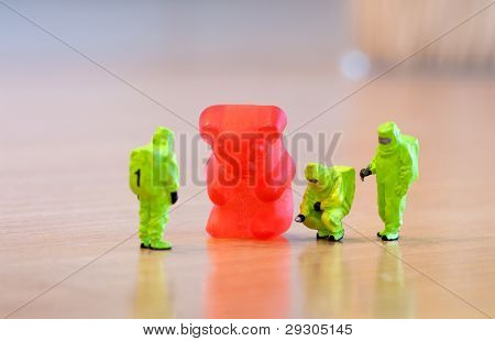 Group Of People In Protective Suit Inspecting A Jelly Bear