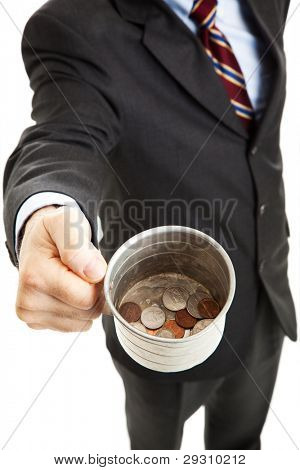 Businessman begging for change in his tin cup.  White background.