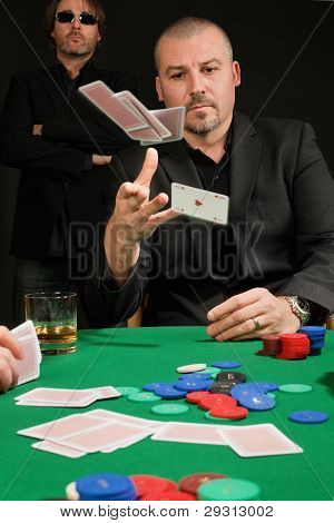 Card Player Throwing In His Hand