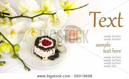 Cake On The Background Of A Beautiful Orchid