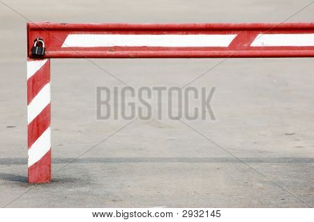 Old Red White Stripy Locked Barrier