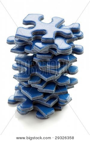 Stack of blue jigsaw puzzle pieces