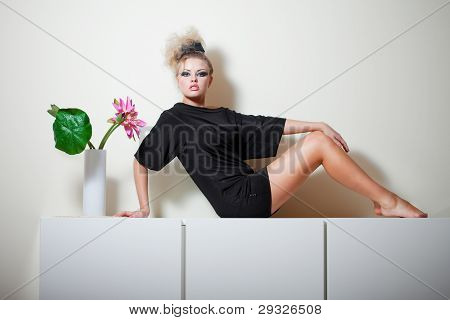 Glamorous Girl In A Black Dress With A Beautiful Vase With A Flower On A White Background