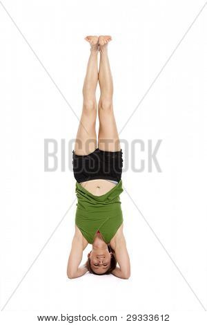 woman doing yoga, in headstand, with clipping path