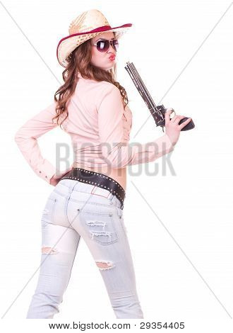 Pretty girl with cowboy hat with revolver
