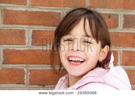 Winter Portrait Of A Happy Little Girl