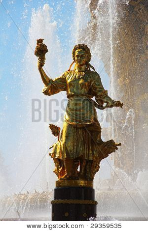 The woman representing Ukraine in the Friendship of Nations fountain