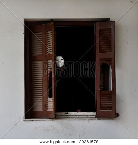 Masked Figure And Broken Window Shutter