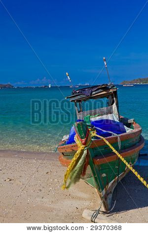 A Wooden Fishing Boat On The Beach