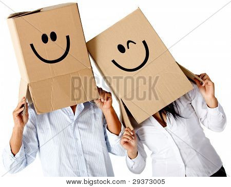 Couple of cardbord characters with smiley faces - isolated over a white background