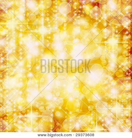 Background Of Defocussed Golden Lights With Sparkles