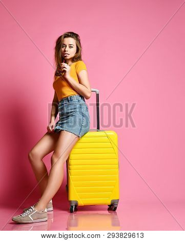 poster of Traveler Tourist Woman In Summer Casual Clothes With Travel Suitcase Isolated On Pink Background. Tr