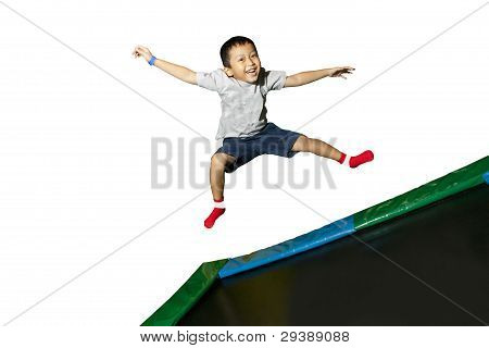 Happy Schoolboy Jumping On White