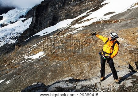 Alpinist contemplating the Eiger Glacier, Switzerland