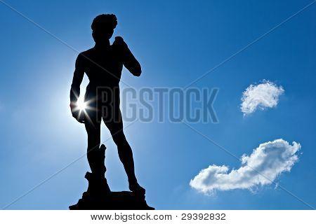 Michelangelos David with sunburst and blue sky