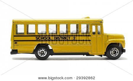 yellow school bus toy, isolated on white background.