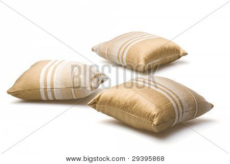 three pillows isolated on white background.