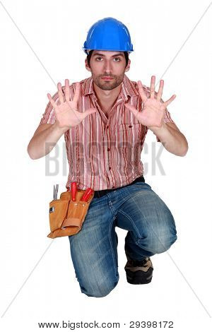 Tradesman holding up his hands
