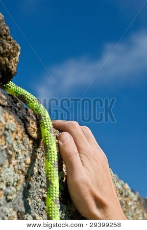 Rockclimber's Hands And Rope