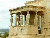 The Famous Caryatid Porch Of The Erechtheum Ancient Greek Temple On The Acropolis Of Athens, Greece poster