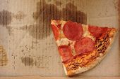 Pizza Box With Single Slice Of Old Pepperoni Pizza In Delivery Box Left After The Party. Cold Pizza  poster