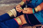 Womans Hands And Legs In Traditional Bracelets Long Neck Wearing At Traditional Costume. Tribal Vill poster