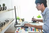 Image Of Male Creative Graphic Designer Working On Color Selection And Drawing On Graphics Tablet At poster