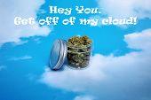 Marijuana. Cannabis. Jar of Marijuana in a blue sky with white clouds. Room for text. Medical Mariju poster