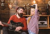 Romantic Evening Concept. Lady And Man With Beard On Happy Faces Hugs And Plays Guitar. Couple In Lo poster