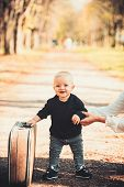 Child Travel For Vacation With Bag With Mothers Hand. Small Boy Carry Retro Suitcase On Natural Land poster