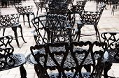 foto of wrought iron  - Wrought iron furniture on the outdoor cafe patio - JPG