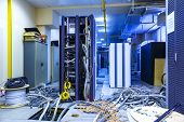 Server Room With Racks In Datacenter And Internet Problem Causing By Disorder Of Wiring. poster