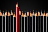 Business Concept Of Disruption, Leadership Or Think Different; Red Pencil In Front Of Row Of Black P poster