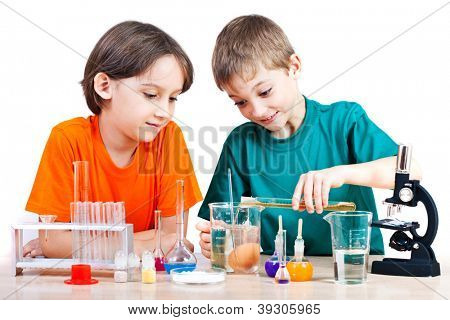 Two little boys doing biochemistry research at the lab. Isolated on white